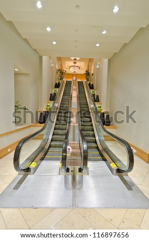 Empty escalator stairs. Fragment of the lobby of the five stars hotel. Interior design. - stock photo