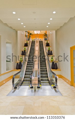 Empty escalator stairs in the hotel. Fragment of the lobby of the five stars hotel. Interior design. - stock photo