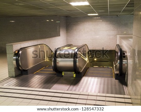 Empty escalator stairs in the Terminal ( underground Mall ) - stock photo
