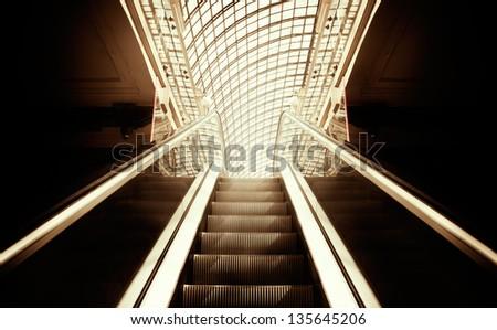 Empty escalator stairs ,selective focus on nearest part - stock photo