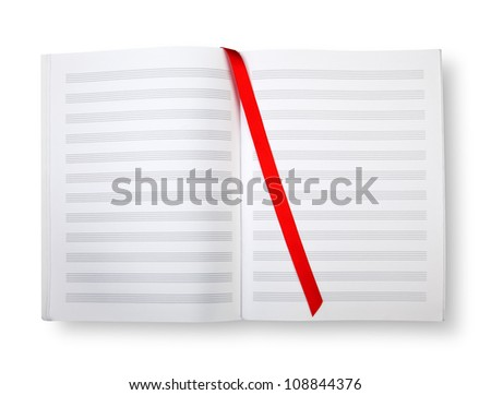 Empty exercise book with pentagrams, bookmark on white and shadow (clipping path) - stock photo