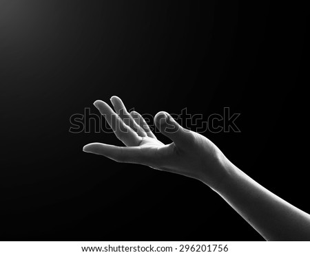 Empty female open human left hands with palms up reaching for lights in black and white tone : Pray for spiritual support and helping concept : Night of power, novel, destiny: Nirvana enlightenment