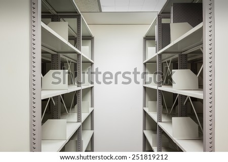 empty filing cabinet with wheel for business document secret and safety - stock photo