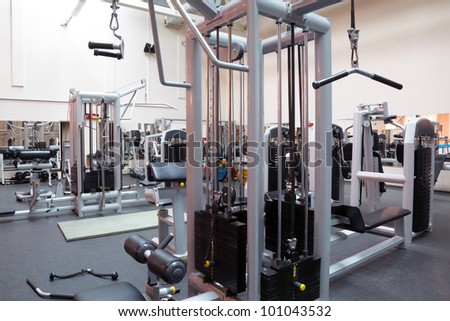 Empty fitness center hall - stock photo