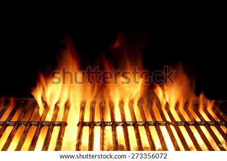Empty Flaming Charcoal Grill  With Flames Of Fire On Black Background Closeup. Summer Outdoor Barbeque Party or Picnic Concept. - stock photo
