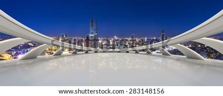 Empty floor with modern city skyline - stock photo