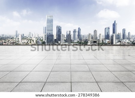 Empty floor with modern skyline and buildings - stock photo