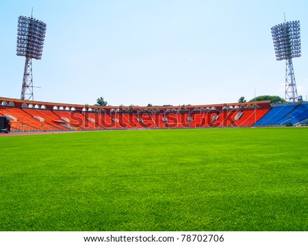empty football field cup with lamps and green grass - stock photo