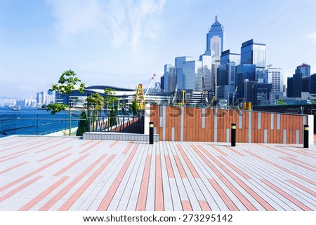 Empty footpath with cityscape at far away  - stock photo