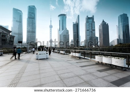 Empty footpath with modern skyline and buildings. - stock photo