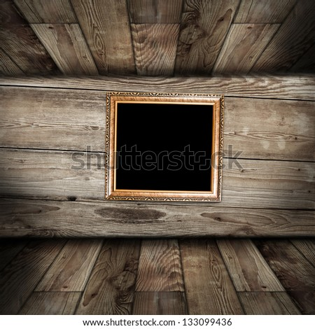 Empty frame in vintage wooden room - stock photo