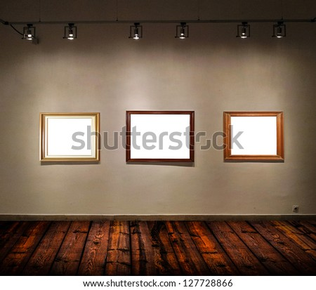 Empty frames in big gallery room - stock photo