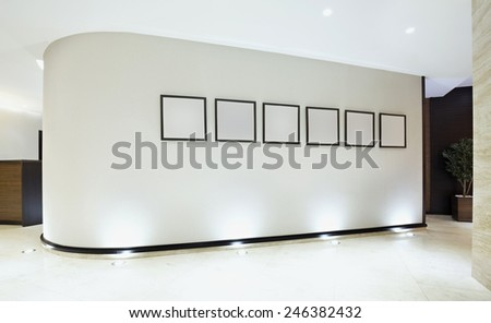 Empty frames on curved wall in modern galery - stock photo