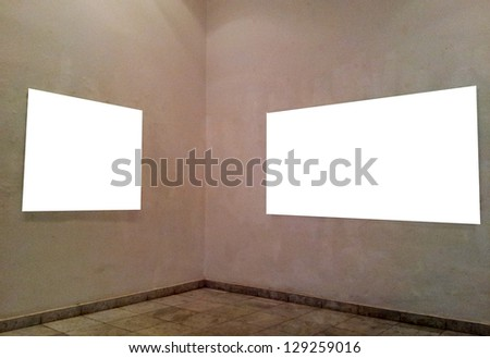 Empty frames on gallery wall - stock photo