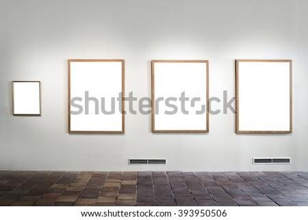 empty gallery with empty frames indoor - stock photo