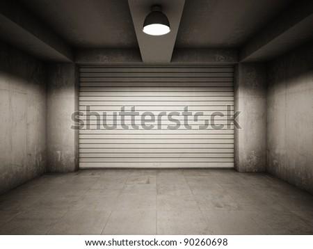 Empty garage illuminated by lamp - stock photo