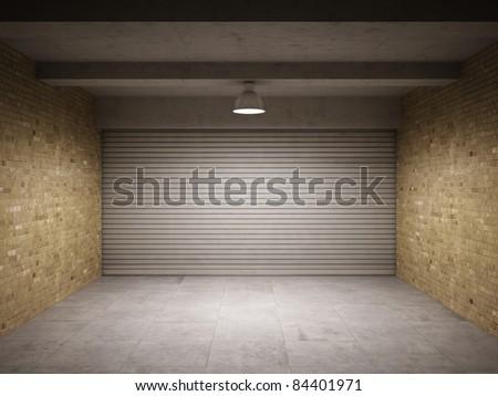 Empty garage with metallic roller shutter door - stock photo