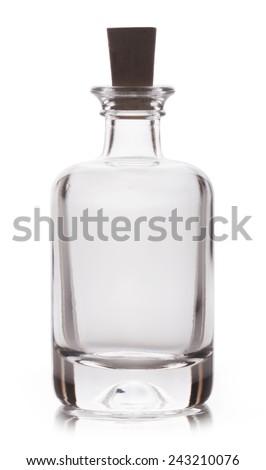 Empty glass bottle isolated on white background - stock photo