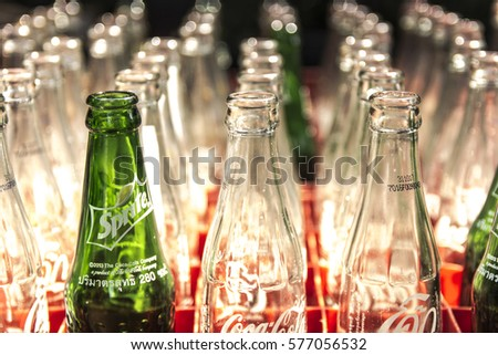 "Empty glass bottle of Coke and Sprite soft drink. Glass bottles in plastic crates. Keep orderly Restaurants in Thailand ""Ban Bang"" in Bangkok."