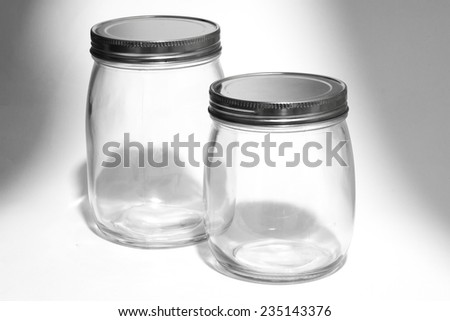 Empty glass canister in white background - stock photo