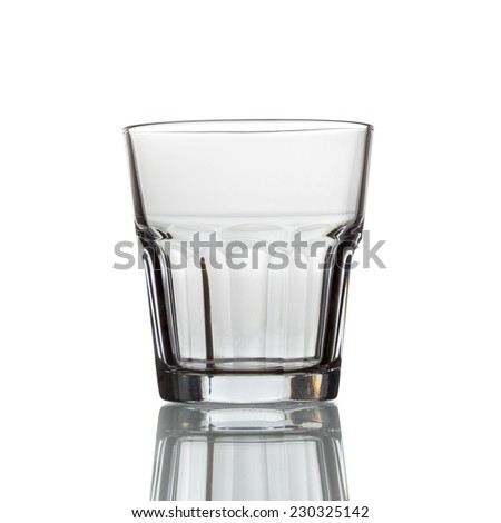 empty glass cup with shadow for whiskey on a white background - stock photo
