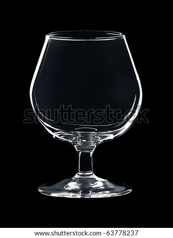 empty glass for cognac isolated over black background - stock photo