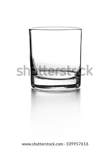 Empty glass for whiskey on white background - stock photo