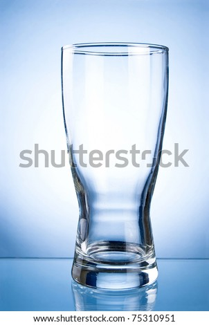 Empty glass glass for drinks on a blue background - stock photo