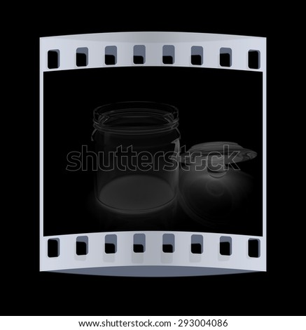 Empty glass jar with cover isolated on black background. The film strip