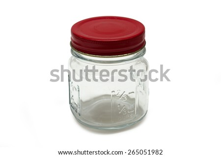 Empty glass jar with red cover. - stock photo