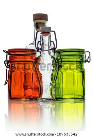 Empty glass jars and empty little glass bottles isolated on white background - stock photo
