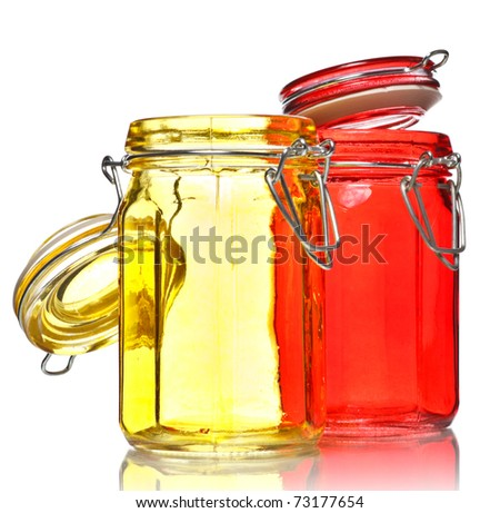 empty glass jars for spice isolated on white