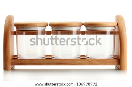 empty glass jars for spices on wooden shelf isolated on white