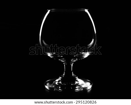 empty glass of beer isolated over black bsckground - stock photo