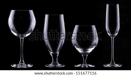 empty glass of champagne isolated on black background