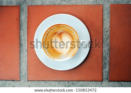 Empty Glass of Coffee on brown floor. - stock photo