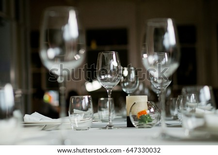 empty glass of water on table wood with dish