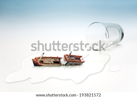 Empty glass of water with Boat capsized (surreal concept) - stock photo