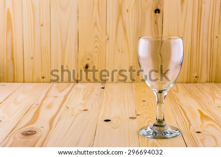 Empty Glass of wine on the brown wooden background - stock photo