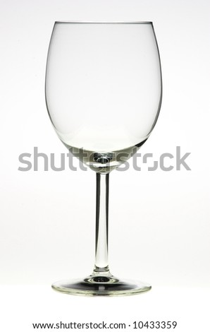 Empty glass of wine on white backround - stock photo