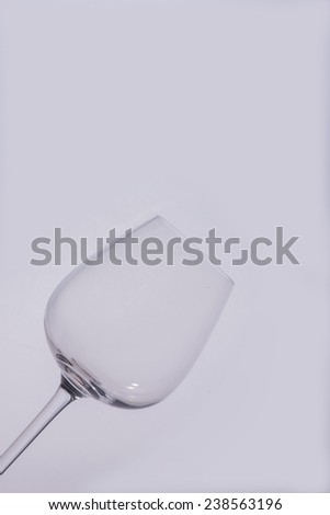Empty glass of wine standing isolated on the white background - stock photo
