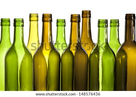 Empty glass wine bottles, washed and ready for recycling. - stock photo