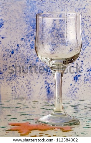 empty glass with a colored background