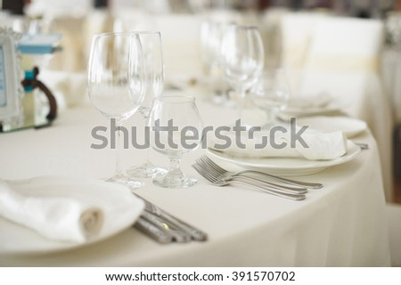 empty glasses and plates with forks - stock photo