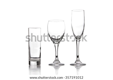 Empty glasses for water, wine and champagne, isolated on white background
