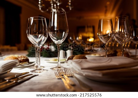 Empty glasses in restaurant. Table setting for celebration - stock photo