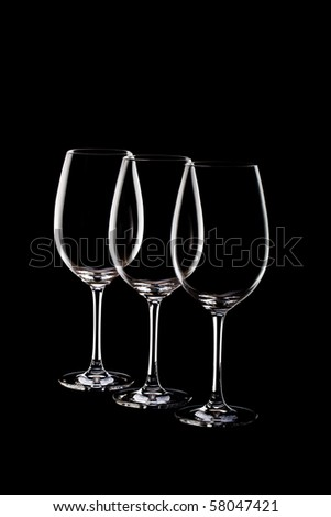 empty glasses on black background