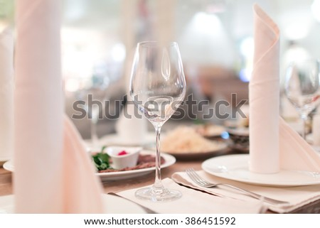 Empty glasses on restaurant table - stock photo