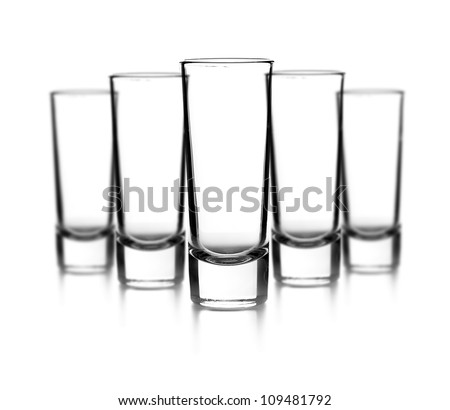 Empty glasses on white background