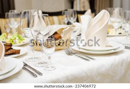 Empty glasses set in restaurant - stock photo